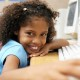 Young Girl at School Holding a Computer Mouse --- Image by © Royalty-Free/Corbis